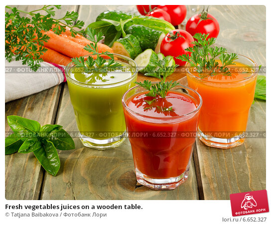 Купить «Fresh vegetables juices on a wooden table.», фото № 6652327, снято 14 августа 2014 г. (c) Tatjana Baibakova / Фотобанк Лори