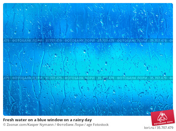 Fresh water on a blue window on a rainy day. Стоковое фото, фотограф Zoonar.com/Kasper Nymann / age Fotostock / Фотобанк Лори