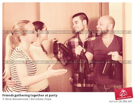 Купить «Friends gathering together at party», фото № 26389347, снято 23 февраля 2019 г. (c) Яков Филимонов / Фотобанк Лори