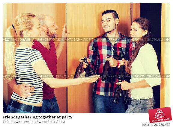 Купить «Friends gathering together at party», фото № 26730427, снято 20 февраля 2019 г. (c) Яков Филимонов / Фотобанк Лори