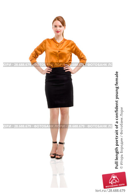 Купить «Full length portrait of a confident young female», фото № 28688679, снято 12 декабря 2018 г. (c) Игорь Бородин / Фотобанк Лори