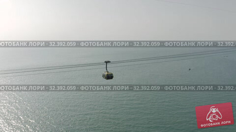 Купить «Funicular cable car on Phu Quoc Island to Hon Thom Pineapple Island in Vietnam», видеоролик № 32392059, снято 4 ноября 2019 г. (c) Aleksejs Bergmanis / Фотобанк Лори