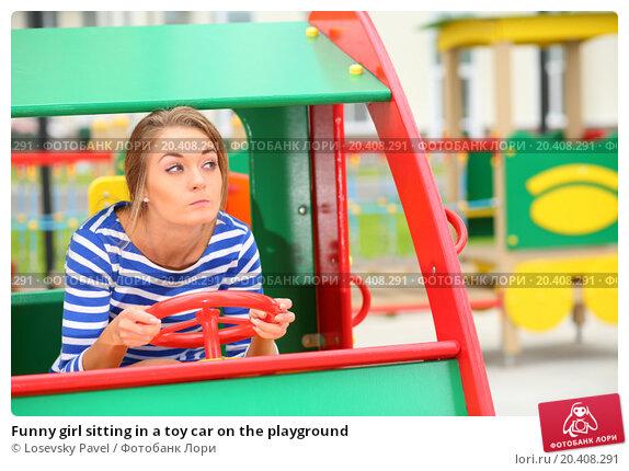 Купить «Funny girl sitting in a toy car on the playground», фото № 20408291, снято 4 августа 2013 г. (c) Losevsky Pavel / Фотобанк Лори