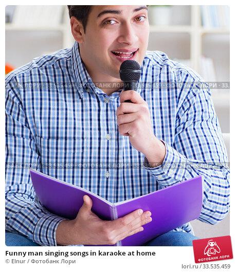 Купить «Funny man singing songs in karaoke at home», фото № 33535459, снято 29 марта 2017 г. (c) Elnur / Фотобанк Лори