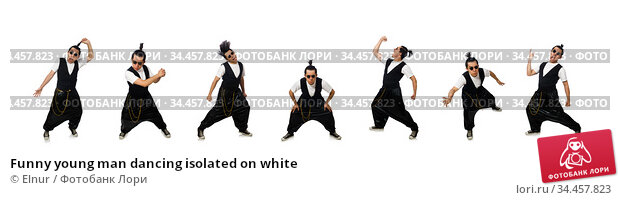Funny young man dancing isolated on white. Стоковое фото, фотограф Elnur / Фотобанк Лори