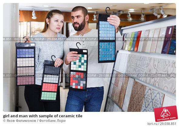 Купить «girl and man with sample of ceramic tile», фото № 29038851, снято 2 февраля 2018 г. (c) Яков Филимонов / Фотобанк Лори