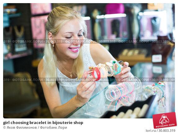 Купить «girl choosing bracelet in bijouterie shop», фото № 30803319, снято 25 июня 2019 г. (c) Яков Филимонов / Фотобанк Лори