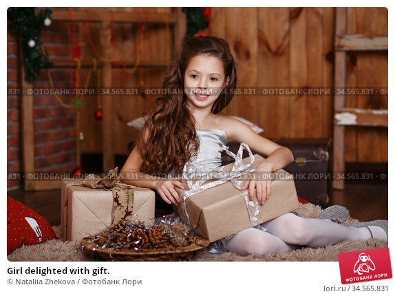 Girl delighted with gift. Стоковое фото, фотограф Nataliia Zhekova / Фотобанк Лори