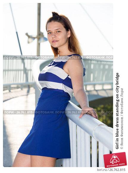 Купить «Girl in blue dress standing on city bridge», фото № 26762815, снято 5 июля 2017 г. (c) Яков Филимонов / Фотобанк Лори