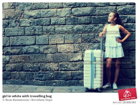Купить «girl in white with travelling bag», фото № 28808083, снято 17 августа 2017 г. (c) Яков Филимонов / Фотобанк Лори