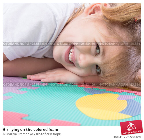 Girl lying on the colored foam. Стоковое фото, фотограф Mariya Eremenko / Фотобанк Лори