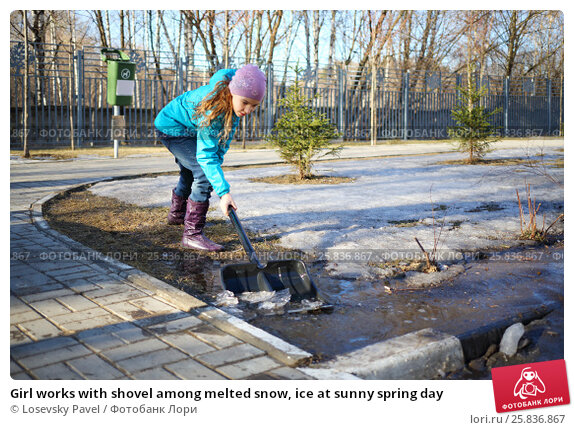 Купить «Girl works with shovel among melted snow, ice at sunny spring day», фото № 25836867, снято 15 марта 2015 г. (c) Losevsky Pavel / Фотобанк Лори