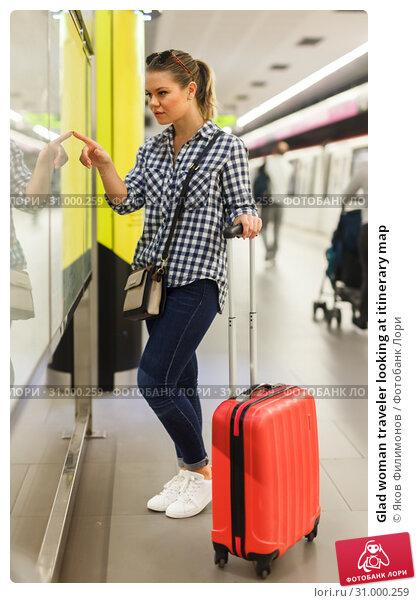 Купить «Glad woman traveler looking at itinerary map», фото № 31000259, снято 27 апреля 2018 г. (c) Яков Филимонов / Фотобанк Лори