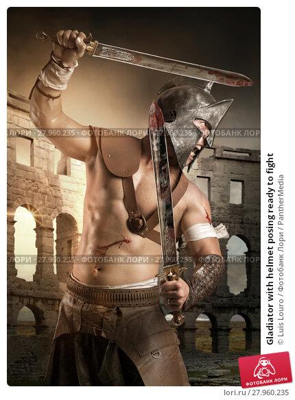 Купить «Gladiator with helmet posing ready to fight», фото № 27960235, снято 7 декабря 2018 г. (c) PantherMedia / Фотобанк Лори