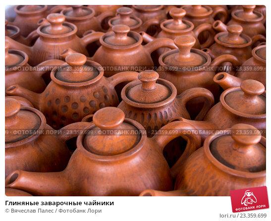 Купить «Глиняные заварочные чайники», фото № 23359699, снято 5 июня 2016 г. (c) Вячеслав Палес / Фотобанк Лори