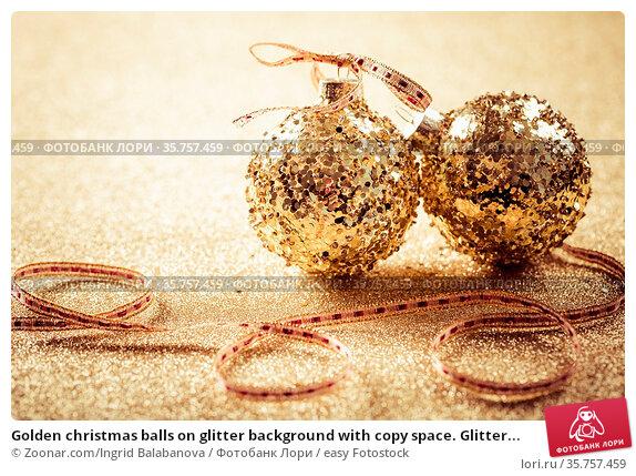 Golden christmas balls on glitter background with copy space. Glitter... Стоковое фото, фотограф Zoonar.com/Ingrid Balabanova / easy Fotostock / Фотобанк Лори