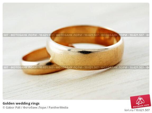 Golden wedding rings . Стоковое фото, фотограф Gábor Páll / PantherMedia / Фотобанк Лори