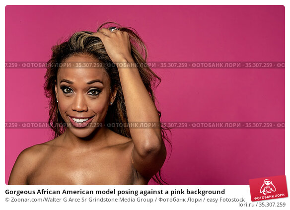 Gorgeous African American model posing against a pink background. Стоковое фото, фотограф Zoonar.com/Walter G Arce Sr Grindstone Media Group / easy Fotostock / Фотобанк Лори