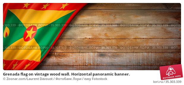 Grenada flag on vintage wood wall. Horizontal panoramic banner. Стоковое фото, фотограф Zoonar.com/Laurent Davoust / easy Fotostock / Фотобанк Лори