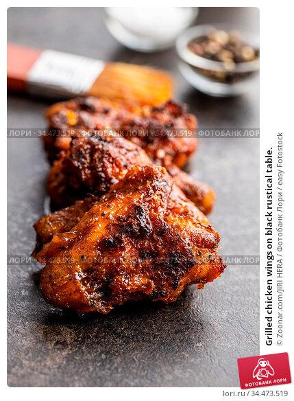 Grilled chicken wings on black rustical table. Стоковое фото, фотограф Zoonar.com/JIRI HERA / easy Fotostock / Фотобанк Лори
