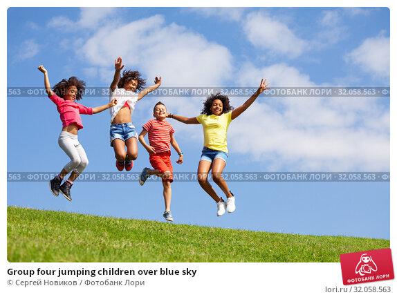 Group four jumping children over blue sky. Стоковое фото, фотограф Сергей Новиков / Фотобанк Лори