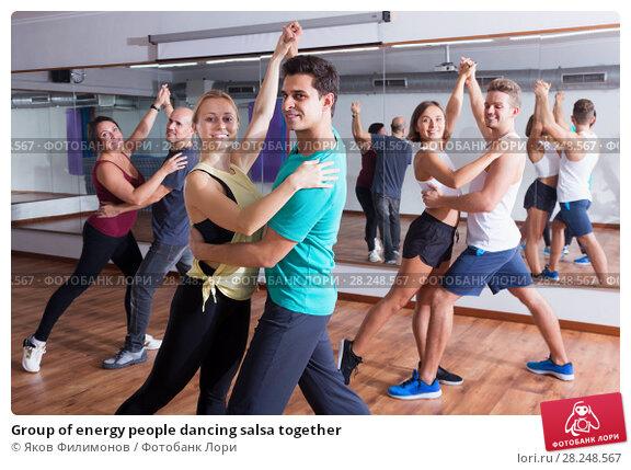 Купить «Group of energy people dancing salsa together», фото № 28248567, снято 24 апреля 2019 г. (c) Яков Филимонов / Фотобанк Лори