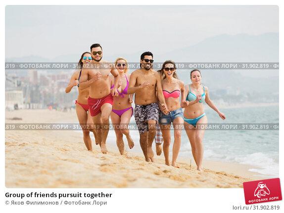 Купить «Group of friends pursuit together», фото № 31902819, снято 26 мая 2020 г. (c) Яков Филимонов / Фотобанк Лори
