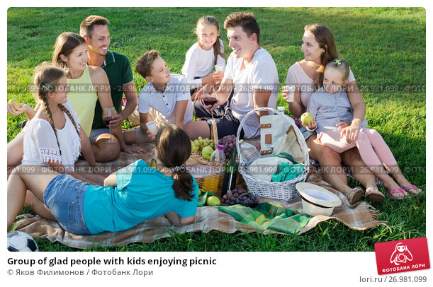 Group of glad people with kids enjoying picnic, фото № 26981099, снято 18 октября 2017 г. (c) Яков Филимонов / Фотобанк Лори
