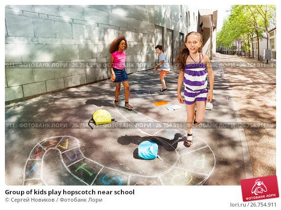 Купить «Group of kids play hopscotch near school», фото № 26754911, снято 17 июня 2017 г. (c) Сергей Новиков / Фотобанк Лори