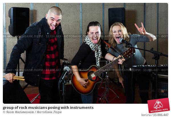 group of rock musicians posing with instruments. Стоковое фото, фотограф Яков Филимонов / Фотобанк Лори