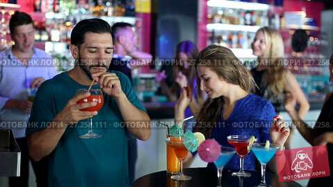 Купить «Group of smiling people clubbing in the night club with drinks», видеоролик № 27258111, снято 11 августа 2017 г. (c) Яков Филимонов / Фотобанк Лори