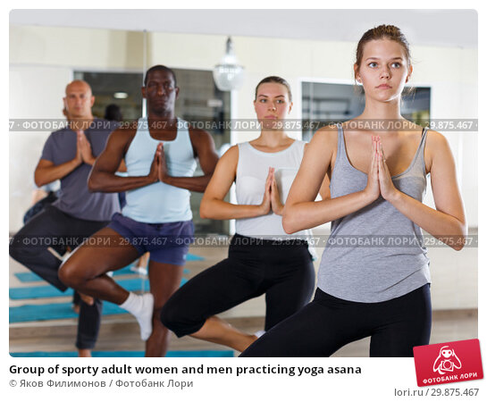 Купить «Group of sporty adult women and men practicing yoga asana», фото № 29875467, снято 30 июля 2018 г. (c) Яков Филимонов / Фотобанк Лори