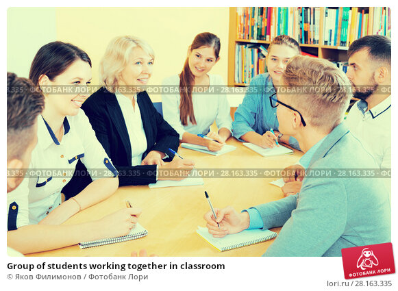 Купить «Group of students working together in classroom», фото № 28163335, снято 5 октября 2017 г. (c) Яков Филимонов / Фотобанк Лори