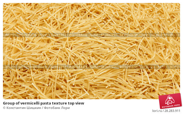 Купить «Group of vermicelli pasta texture top view», фото № 28283911, снято 9 апреля 2018 г. (c) Константин Шишкин / Фотобанк Лори
