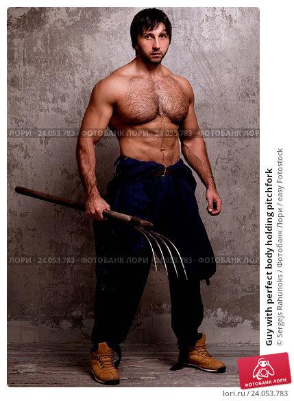 Купить «Guy with perfect body holding pitchfork», фото № 24053783, снято 7 октября 2014 г. (c) easy Fotostock / Фотобанк Лори
