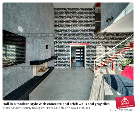 Hall in a modern style with concrete and brick walls and gray tiles... Стоковое фото, фотограф Zoonar.com/Andriy Bezuglov / easy Fotostock / Фотобанк Лори
