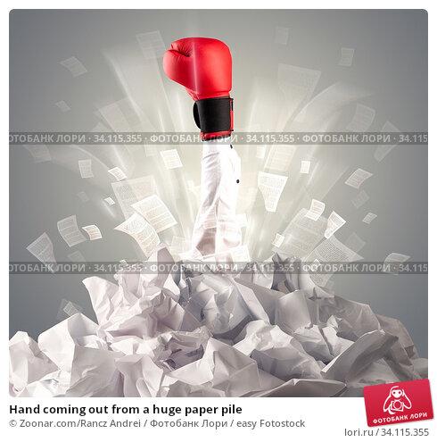 Купить «Hand coming out from a huge paper pile», фото № 34115355, снято 11 июля 2020 г. (c) easy Fotostock / Фотобанк Лори