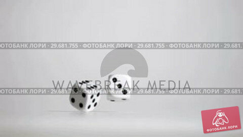 Купить «Hand in super slow motion throwing a pair of dice», видеоролик № 29681755, снято 17 января 2019 г. (c) Wavebreak Media / Фотобанк Лори