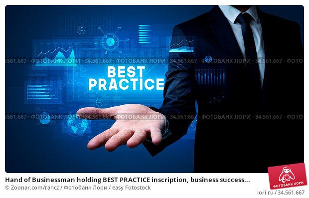 Hand of Businessman holding BEST PRACTICE inscription, business success... Стоковое фото, фотограф Zoonar.com/rancz / easy Fotostock / Фотобанк Лори