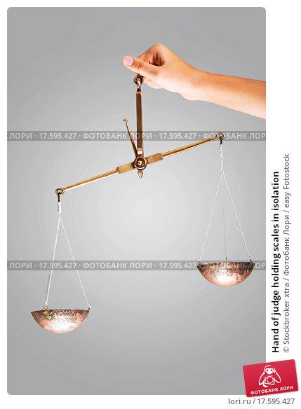 Купить «Hand of judge holding scales in isolation», фото № 17595427, снято 4 июля 2020 г. (c) easy Fotostock / Фотобанк Лори