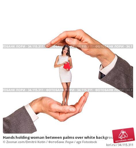 Купить «Hands holding woman between palms over white background», фото № 34115311, снято 11 июля 2020 г. (c) age Fotostock / Фотобанк Лори