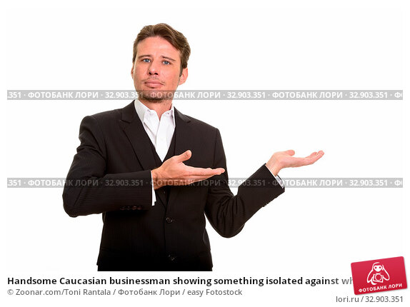 Handsome Caucasian businessman showing something isolated against white background. Стоковое фото, фотограф Zoonar.com/Toni Rantala / easy Fotostock / Фотобанк Лори