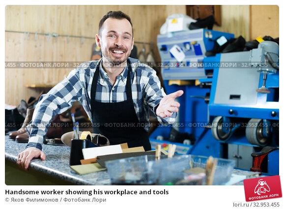 Handsome worker showing his workplace and tools. Стоковое фото, фотограф Яков Филимонов / Фотобанк Лори