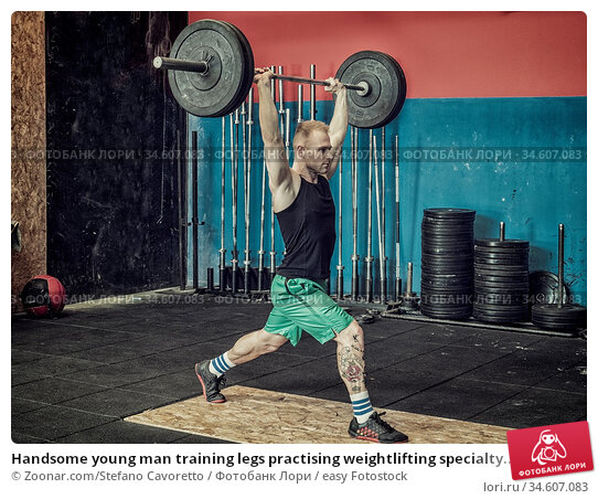 Handsome young man training legs practising weightlifting specialty... Стоковое фото, фотограф Zoonar.com/Stefano Cavoretto / easy Fotostock / Фотобанк Лори