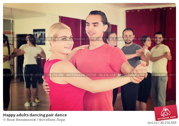 Купить «Happy adults dancing pair dance», фото № 30216559, снято 20 апреля 2019 г. (c) Яков Филимонов / Фотобанк Лори