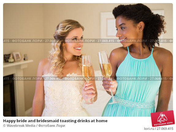 Купить «Happy bride and bridesmaid toasting drinks at home», фото № 27069415, снято 2 мая 2017 г. (c) Wavebreak Media / Фотобанк Лори