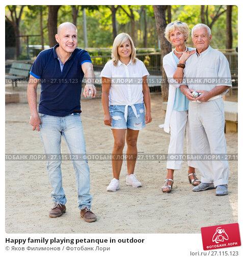 Купить «Happy family playing petanque in outdoor», фото № 27115123, снято 24 августа 2017 г. (c) Яков Филимонов / Фотобанк Лори