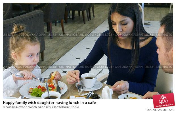 Купить «Happy family with daughter having lunch in a cafe», фото № 28581723, снято 18 июня 2018 г. (c) Vasily Alexandrovich Gronskiy / Фотобанк Лори
