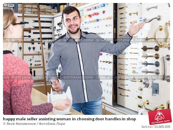 Купить «happy male seller assisting woman in choosing door handles in shop», фото № 33065035, снято 5 апреля 2017 г. (c) Яков Филимонов / Фотобанк Лори
