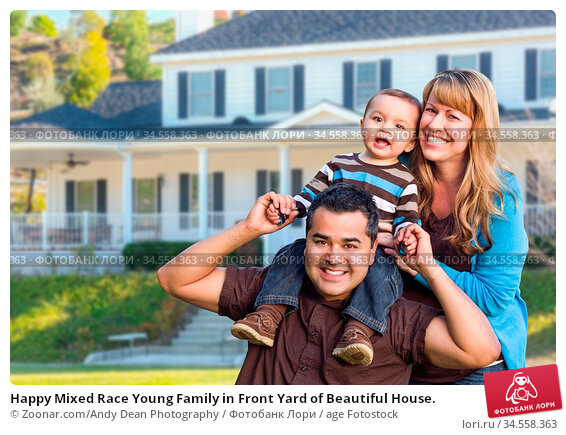 Happy Mixed Race Young Family in Front Yard of Beautiful House. Стоковое фото, фотограф Zoonar.com/Andy Dean Photography / age Fotostock / Фотобанк Лори
